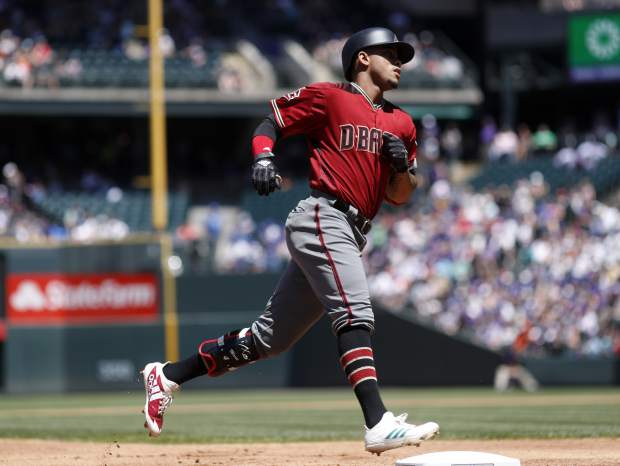 Arizona Diamondbacks' Ketel Marte circles the bases after hitting a solo home run off Colorado Rockies starting pitcher Kyle Freeland in the second inning of a baseball game Sunday, June 10, 2018, in Denver. (AP Photo/David Zalubowski)