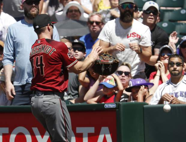 Arizona Diamondbacks first baseman Paul Goldschmidt pursues but does not catch a pop foul ball off the bat of Colorado Rockies' Noel Cuevas in the fifth inning of a baseball game Sunday, June 10, 2018, in Denver. Arizona won 8-3. (AP Photo/David Zalubowski)