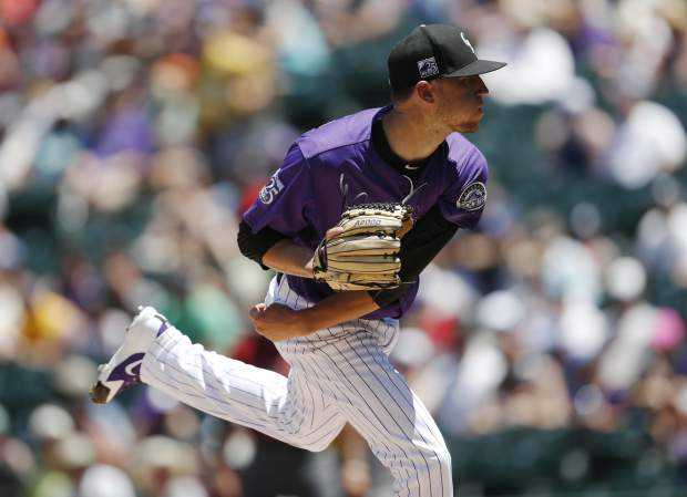 Colorado Rockies starting pitcher Kyle Freeland delivers o Arizona Diamondbacks' Paul Goldschmidt in the first inning of a baseball game against Sunday, June 10, 2018, in Denver. (AP Photo/David Zalubowski)