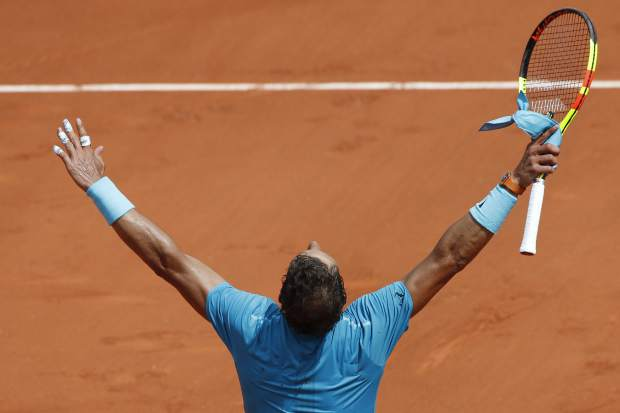 Spain's Rafael Nadal celebrates winning his fourth round match of the French Open tennis tournament against Germany's Maximilian Marterer in three sets, 6-3, 6-2, 7-6 (7-4), at the Roland Garros stadium in Paris, France, Monday, June 4, 2018. (AP Photo/Christophe Ena)