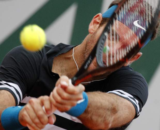 Argentina's Juan Martin del Potro returns a shot against John Isner of the U.S. during their fourth round match of the French Open tennis tournament at the Roland Garros stadium in Paris, France, Monday, June 4, 2018. (AP Photo/Christophe Ena)