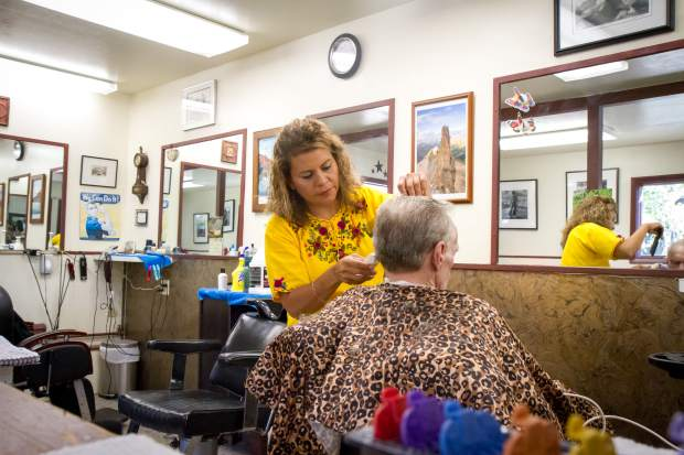 Rosa Contreras, a stylist at The Barber Shop on Main Street in Carbondale, had years of experience in Guatemala, but had to complete cosmetology school and testing before she could do the work in the United States.