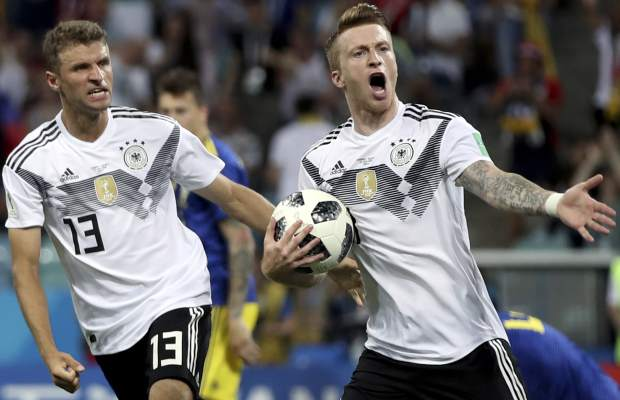 Germany's Marco Reus, right, celebrates with Thomas Mueller after scoring his side's opening goal during the group F match between Germany and Sweden at the 2018 soccer World Cup in the Fisht Stadium in Sochi, Russia, Saturday, June 23, 2018. (AP Photo/Thanassis Stavrakis)