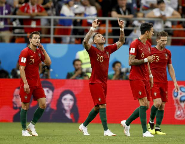 Portugal's Ricardo Quaresma, second left celebrates after he scored the opening goal of the game during the group B match between Iran and Portugal at the 2018 soccer World Cup at the Mordovia Arena in Saransk, Russia, Monday, June 25, 2018. (AP Photo/Francisco Seco)