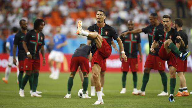 Portugal's Cristiano Ronaldo, centre warms up with his teammates for the group B match between Iran and Portugal at the 2018 soccer World Cup at the Mordovia Arena in Saransk, Russia, Monday, June 25, 2018. (AP Photo/Francisco Seco)