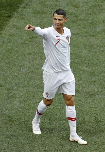 Portugal's Cristiano Ronaldo celebrates after scoring the opening goal during the group B match between Portugal and Morocco at the 2018 soccer World Cup in the Luzhniki Stadium in Moscow, Russia, Wednesday, June 20, 2018. (AP Photo/Victor Caivano)