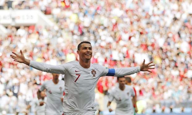 Portugal's Cristiano Ronaldo celebrates after scoring the opening goal during the group B match between Portugal and Morocco at the 2018 soccer World Cup in the Luzhniki Stadium in Moscow, Russia, Wednesday, June 20, 2018. (AP Photo/Francisco Seco)