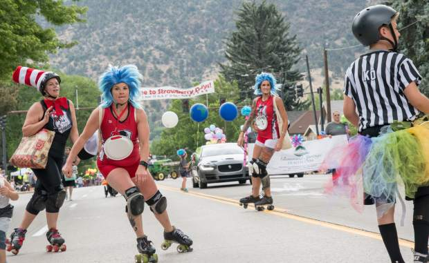 Members of a roller derby team make their way down Grand Avenue during the 2018 Strawberry Days Parade on Saturday morning.