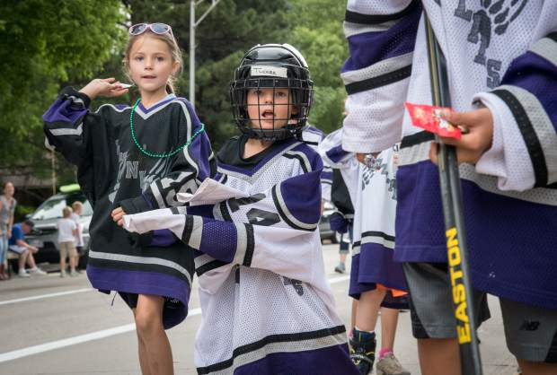 Members of the Grizzly Hockey Team make their way down Grand Avenue during the 2018 Strawberry Days Parade on Saturday morning.