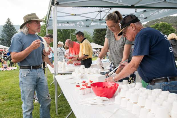 Park goers enjoy free strawberries and ice cream at Sayre Park after the 2018 Strawberry Days Parade on Saturday morning.