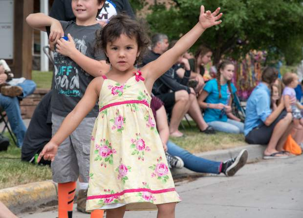 Parade goers watch floats and grab as much candy as possible during the 2018 Strawberry Days Parade on Saturday morning.