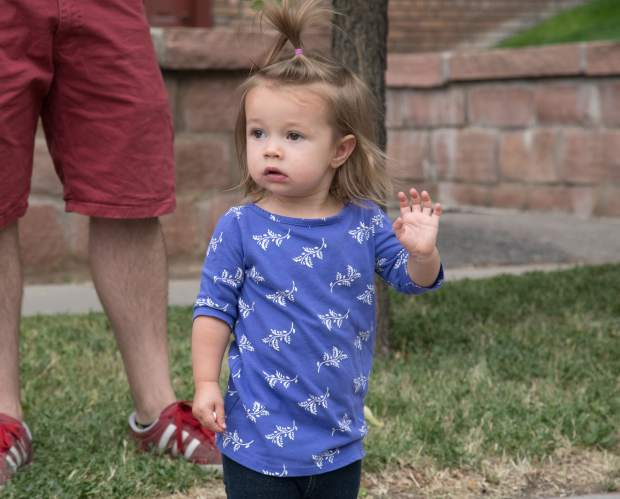A little girl waves to the firetrucks, floats and more during the 2018 Strawberry Days Parade on Saturday morning.
