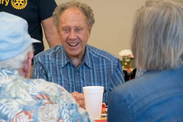 Bob Ludtke chats with friends at the annual Pie Day on Friday morning.