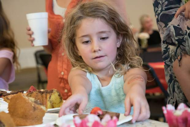 Six-year-old Mackenzie Lambert picks out her pie at the annual Pie Day on Friday morning.