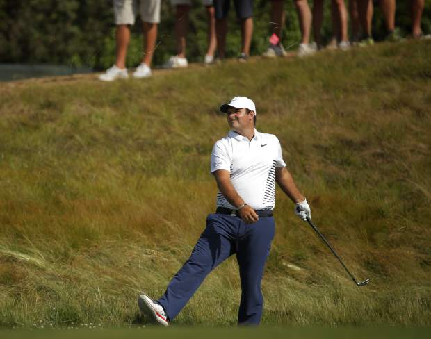 Patrick Reed reacts after a shot on the 12th fairway during the final round of the U.S. Open Golf Championship, Sunday, June 17, 2018, in Southampton, N.Y. (AP Photo/Carolyn Kaster)