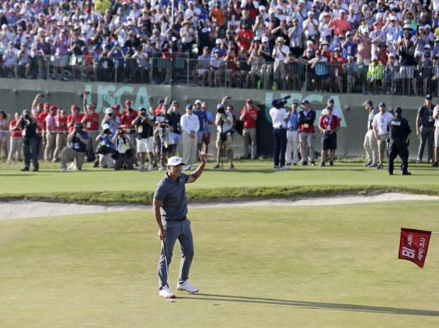 Brooks Koepka reacts after finishing the final round of the U.S. Open Golf Championship, Sunday, June 17, 2018, in Southampton, N.Y. (AP Photo/Seth Wenig)