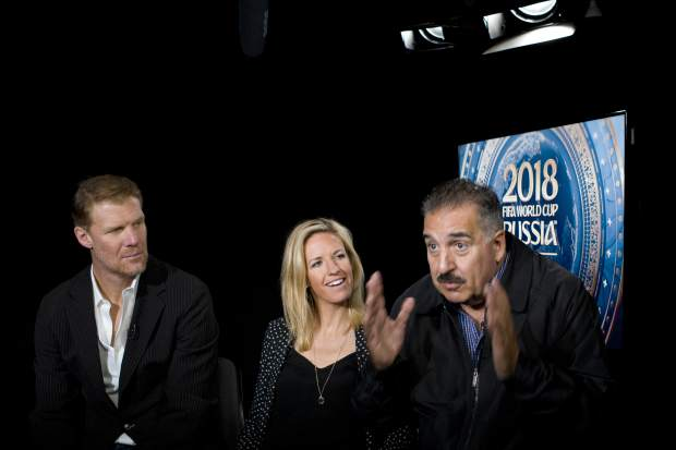Alexi Lalas, left, Aly Wagner and Fernando Fiore talk during an interview, Wednesday, May 30, 2018, in New York. They will be part of Fox Sports coverage of the 2018 FIFA World Cup.(AP Photo/Mark Lennihan)