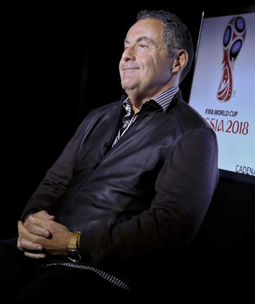 Argentine sportscaster and legendary Telemundo soccer broadcaster Andres Cantor smiles during an interview about his 2018 World Cup assignment, Wednesday May 16, 2018, in New York. Getting ready to broadcast its first World Cup, Telemundo hopes Cantor can persuade American viewers that soccer is better in Spanish. (AP Photo/Bebeto Matthews)