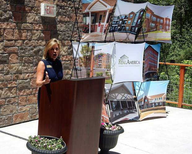 Ronda Weybright, founder and president of RealAmerica, talks about the Roaring Fork Apartments project at a ribbon-cutting ceremony Monday.