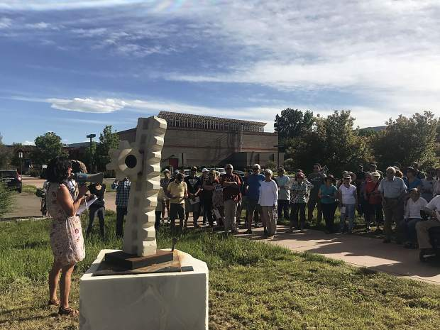 Sarah Moore speaks to the art walk crowd about Chester Haring's