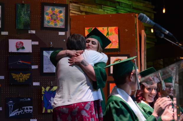 Jessica Hughes hugs Bridges High School principal, Lyn Bair after receiving the principal's award at the school's graduation in Carbondale on June 1, 2018.