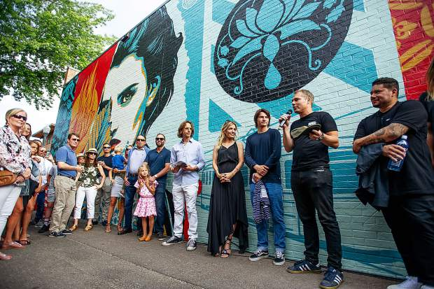 Artist Shepard Fairey speaking at the unveiling of his mural,