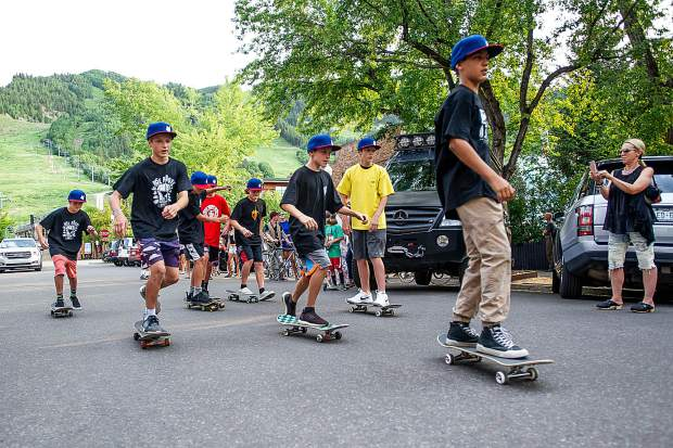 Local youth skateboarders lead the community Obey parade to the 212 gallery in Aspen on Thursday after unveiling the mural by artist Shepard Fairey.