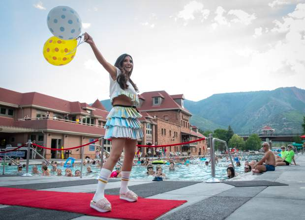 Miss Strawberry Days contest Angelica Andrade poses for the camera and crowd at the 2018 Miss Strawberry Days Fashion Show at the Glenwood Hot Springs Pool on Thursday evening.