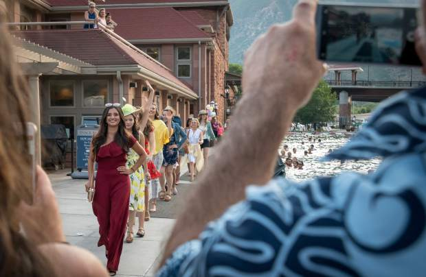Friends and family of the 2018 Miss Strawberry Days contestants take photos and cheer them on during the fashion show at the Glenwood Hot Springs Pool on Thursday evening.