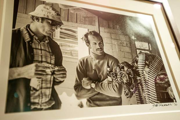Hunter S. Thompson and mayoral candidate Joe Edwards, inspect a bullet-laden sculpture, 1969. Photo by Bob Krueger.