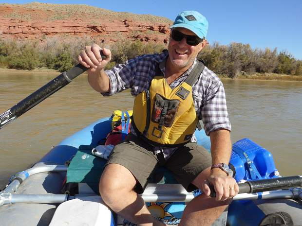 Sloan Shoemaker hits the Colorado River upstream of Moab. He worked for Wilderness Workshop for 21 years to help keep wild places wild. He is stepping down after a transition this summer.