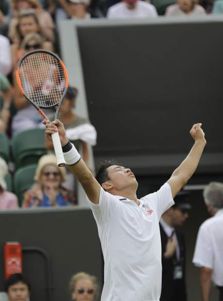 Kei Nishikori of Japan celebrates defeating Ernests Gulbis of Latvia in their men's singles match on the seventh day at the Wimbledon Tennis Championships in London, Monday July 9, 2018. (AP Photo/Ben Curtis)