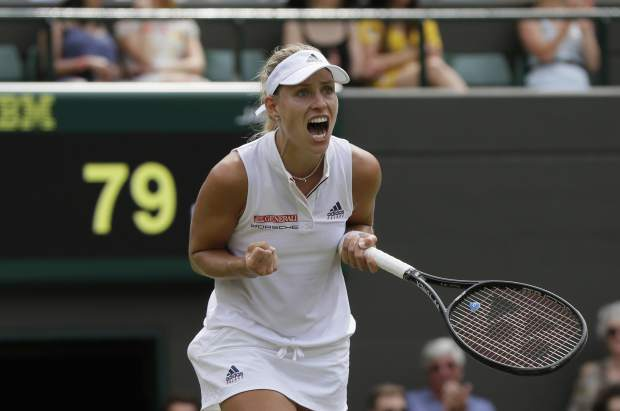 Angelique Kerber of Germany celebrates defeating Belinda Bencic of Switzerland in their women's singles match on the seventh day at the Wimbledon Tennis Championships in London, Monday July 9, 2018. (AP Photo/Kirsty Wigglesworth)