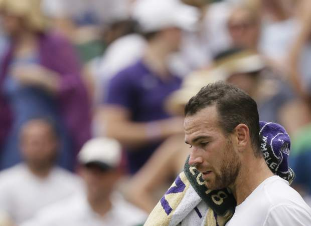 France's Adrian Mannarino is dejected during his men's singles match against Roger Federer of Switzerland, on day seven of the Wimbledon Tennis Championships, in London, Monday July 9, 2018. (AP Photo/Tim Ireland)