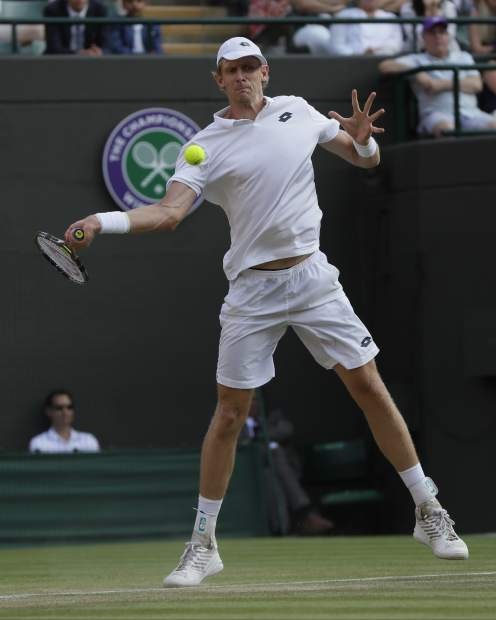 Kevin Anderson of South Africa returns a ball to Gael Monfils of France during their men's singles match on the seventh day at the Wimbledon Tennis Championships in London, Monday July 9, 2018. (AP Photo/Kirsty Wigglesworth)