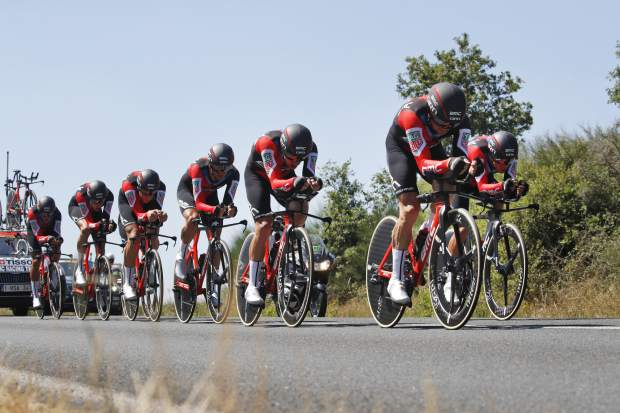 BMC Racing Team strains during the third stage of the Tour de France cycling race, a team time trial over 35.5 kilometers (22 miles) with start and finish in Cholet, France, Monday, July 9, 2018. (AP Photo/Christophe Ena)
