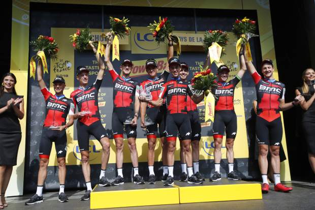 Riders of the BMC Racing Team celebrate after winning the third stage of the Tour de France cycling race, a team time trial over 35.5 kilometers (22 miles) with start and finish in Cholet, France, Monday, July 9, 2018. (AP Photo/Christophe Ena )