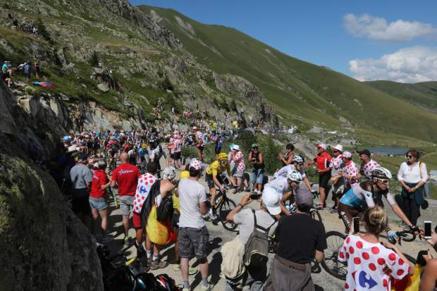 Britain's Geraint Thomas, wearing the overall leader's yellow jersey, climbs Col de Croix de Fer pass during the twelfth stage of the Tour de France cycling race over 175.5 kilometers (109 miles) with start in Bourg-Saint-Maurice Les Arcs and Alpe d'Huez, France, Thursday July 19, 2018. (AP Photo/Peter Dejong)