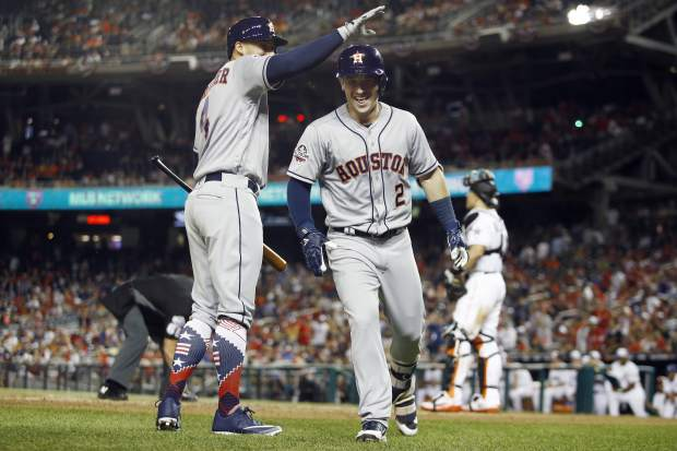Houston Astros George Springer (4) congratulates Houston Astros Alex Bregman (2) on Bregman's solo home run during the tenth inning at the Major League Baseball All-star Game, Tuesday, July 17, 2018 in Washington. (AP Photo/Patrick Semansky)
