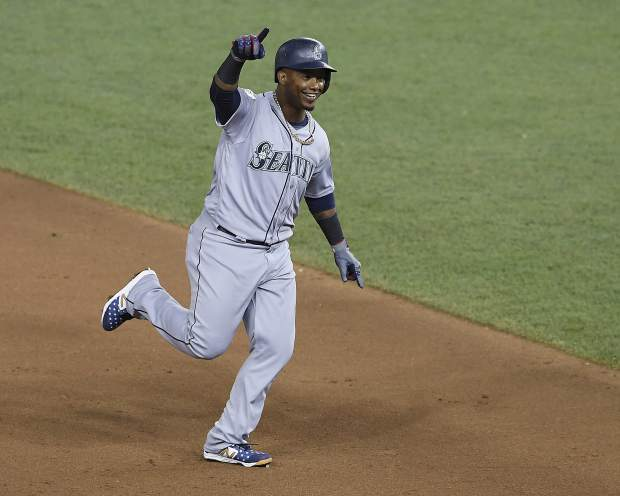 Seattle Mariners Jean Segura (2) points the bench as he rounds the bases on a three-run homer in the eighth inning during the Major League Baseball All-star Game, Tuesday, July 17, 2018 in Washington. (AP Photo/Nick Wass)