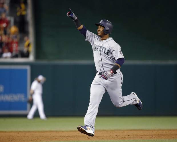 Seattle Mariners Jean Segura (2) celebrates his three-run homer in the eight inning during the Major League Baseball All-star Game, Tuesday, July 17, 2018 in Washington. (AP Photo/Patrick Semansky)