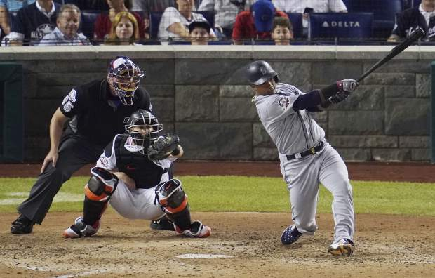 Seattle Mariners Jean Segura (2) hits a three-run homer in the eighth inning during the 89th MLB baseball All-Star Game, Tuesday, July 17, 2018, at Nationals Park, in Washington. (AP Photo/Carolyn Kaster)
