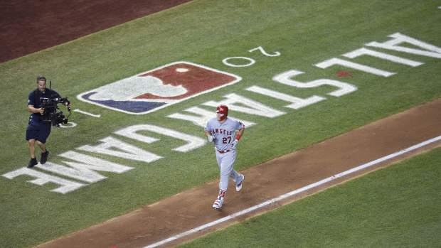 Los Angeles Angels Mike Trout (27) rounds the bases on a solo home run during the second inning of the Major League Baseball All-star Game, Tuesday, July 17, 2018 in Washington. (AP Photo/Nick Wass)