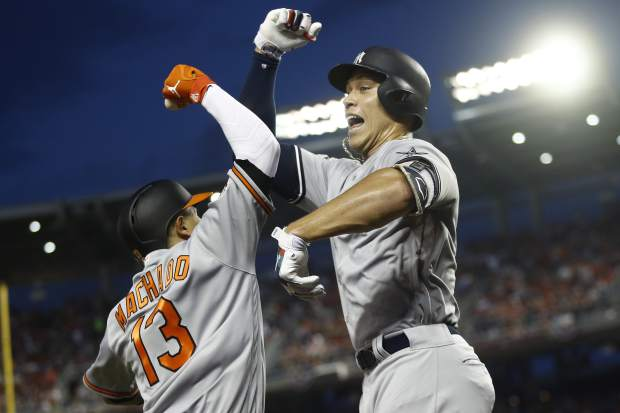 New York Yankees outfielder Aaron Judge (99) celebrates his solo home run with Baltimore Orioles shortstop Manny Machado (13) during the first inning Major League Baseball All-star Game, Tuesday, July 17, 2018 in Washington. (AP Photo/Patrick Semansky)