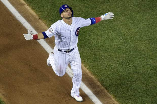 Chicago Cubs catcher Willson Contreras (40) celebrates this third inning solo home run during the Major League Baseball All-star Game, Tuesday, July 17, 2018 in Washington. (AP Photo/Susan Walsh)