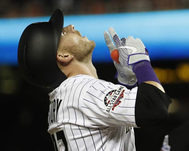 Colorado Rockies shortstop Trevor Story points skyward after his seventh inning solo home run during the Major League Baseball All-star Game, Tuesday, July 17, 2018 in Washington. (AP Photo/Patrick Semansky)
