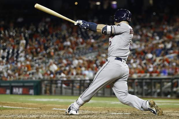 Houston Astros Alex Bregman (2) hits a solo home run in the tenth inning during the Major League Baseball All-star Game, Tuesday, July 17, 2018 in Washington. (AP Photo/Patrick Semansky)