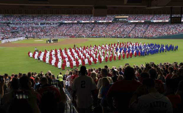 A choir moves on the field before the 89th MLB baseball All-Star Game, Tuesday, July 17, 2018, at Nationals Park, in Washington. (AP Photo/Carolyn Kaster)