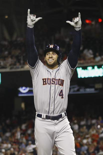 Houston Astros outfielder George Springer (4) celebrates his solo home run in the tenth inning during the Major League Baseball All-star Game, Tuesday, July 17, 2018 in Washington. (AP Photo/Patrick Semansky)