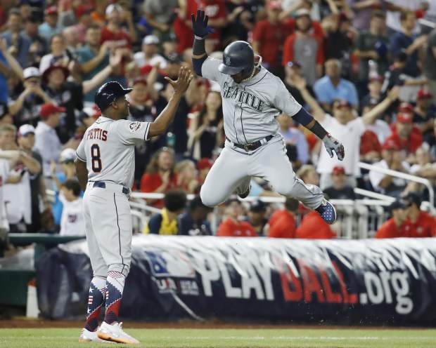 Seattle Mariners shortstop Jean Segura (2) celebrates his three-run homer in the eighth inning during the Major League Baseball All-star Game, Tuesday, July 17, 2018 in Washington. (AP Photo/Alex Brandon)